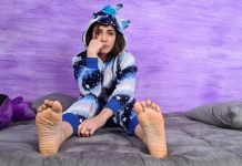 Stunning Aradia In A One-Piece Hooded Pajama And Purple Slippers